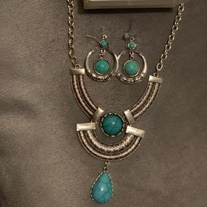 Turquoise statement necklace w/ matching earrings.